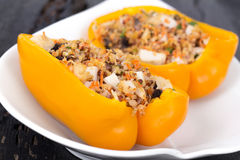 Quinoa chicken stuffed orange peppers Stock Photo