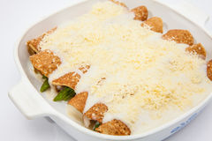 Quinoa crepes with white sauce and parmesan cheese. Quinoa crepes preparation :  Quinoa crepes with white sauce and parmesan cheese Royalty Free Stock Photos