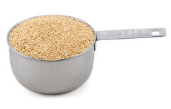 Quinoa in a cup measure Stock Image