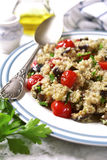 Quinoa with eggplants and grilled tomatoes. Royalty Free Stock Photography