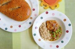 Quinoa en varkenskoteletmaaltijd Royalty-vrije Stock Afbeeldingen