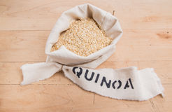 Quinoa flakes in a bag rolled top and stencilled label Stock Images