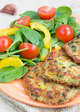 Quinoa fritters and salad Stock Image