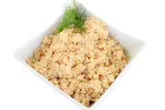 Quinoa grain. Close up on bowl  of cooked quinoa grain on white background Royalty Free Stock Images