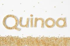 Quinoa grains writing. Quinoa written with raw grains Royalty Free Stock Photos