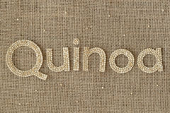 Quinoa grains writing. Quinoa written with raw grains Royalty Free Stock Images