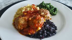 Quinoa, meatballs, black rice and spinach, healthy food stock images