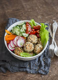Quinoa meatballs and vegetable salad. Buddha bowl on a wooden table. Healthy, diet, vegetarian concept. royalty free stock image