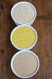 Quinoa, mijo y amaranto (de arriba a abajo) Imagen de archivo libre de regalías