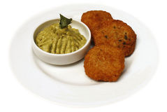 Quinoa nuggets with guacamole Stock Photos