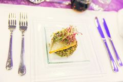 Quinoa, Perch and Soya Sprout Salad on a Square White Plate stock photo