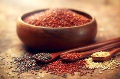 Quinoa. Red, black and white quinoa grains in a wooden bowl. Chenopodium quinoa Stock Photo