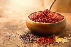 Quinoa. Red, black and white quinoa grains in a wooden bowl. Chenopodium quinoa Stock Photography