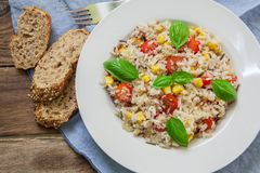 Vegan healthy salad. Quinoa and rice salad with cherry tomatoes and basil Royalty Free Stock Photo