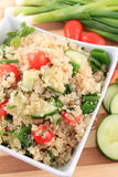 Quinoa salad. Cold quinoa salad with cucumbers, cherry tomatoes, green onions and herbs Royalty Free Stock Images
