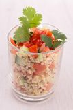 Quinoa salad. Close up on quinoa with tomato and cucumber Royalty Free Stock Photos