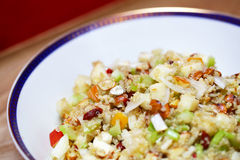 Quinoa salad with apples, celery and goji berries Royalty Free Stock Image