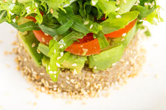 Quinoa salad with avocado and cherry tomatoes. Stock Photography