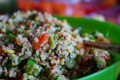 Quinoa Salad. A beautiful quinoa salad, featuring tomato, cucumber and bell peppers Royalty Free Stock Images