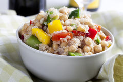 Quinoa Salad in Bowl. Close up of fresh quinoa salad with bell peppers and chickpeas Stock Image