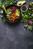Quinoa salad. In bowl with avocado, sweet potato, beans, herbs, spinat on concrete rustic background. Quinoa superfood concept. Clean healthy detox eating Stock Photo