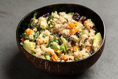 Quinoa salad in a bowl stock images
