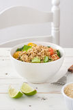Quinoa salad in bowl with tomatoes and spinach Stock Images