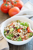 Quinoa salad with fresh vegetables. Quinoa salad with fresh tomatoes, cucumbers and salad leaves Stock Photography