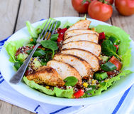 Quinoa salad with grilled chicken and vegetables. Quinoa salad with grilled chicken,corn,spinach leaves and cherry tomatoes Royalty Free Stock Photography