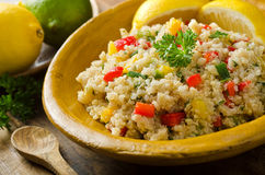 Quinoa Salad. A healthy delicious quinoa salad with lemon, lime, red pepper, yellow pepper, green onion, and parsley Stock Photos