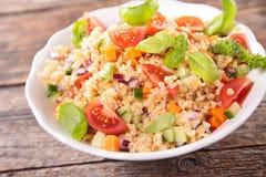 Quinoa salad. With tomato,avocado,cucumber and basil Royalty Free Stock Photography