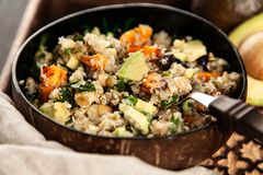 Quinoa salad in a bowl royalty free stock images