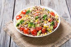 Fresh quinoa salad. Quinoa salad with tomatoes , avocado , broccoli and corn . Vegan superfood Stock Photos