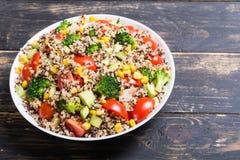 Fresh quinoa salad. Quinoa salad with tomatoes , avocado , broccoli and corn . Vegan superfood Royalty Free Stock Photography