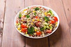 Fresh quinoa salad. Quinoa salad with tomatoes , avocado , broccoli and corn . Vegan superfood Royalty Free Stock Photo
