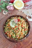 Quinoa salad with vegetables mix,lemon and thyme. Stock Image