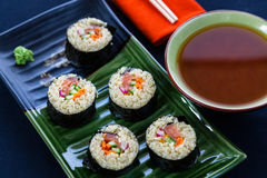 Quinoa and salmon sushi rolls Stock Photos