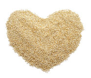 Quinoa seeds forming a heart Royalty Free Stock Image