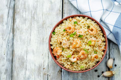 Quinoa with shrimp and parsley Stock Photos