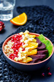 Quinoa spinach beet orange pomegranate blue cheese salad royalty free stock images