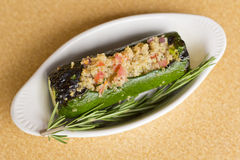 Quinoa Stuffed Zucchini. Grilled quinoa salad stuffed zucchini with rosemary Stock Photography