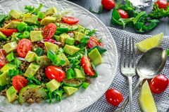 Quinoa tabbouleh salad with avocado, tomatoes, cucumber, green onion. Concept healthy food. Stock Photography