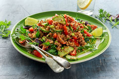 Quinoa tabbouleh salad with tomatoes, cucumber green onion. Concept healthy food Royalty Free Stock Photo