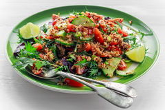 Quinoa tabbouleh salad with tomatoes, cucumber green onion. Concept healthy food Stock Photos