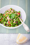 Quinoa tabbouleh salad on a wooden table.  Stock Photography
