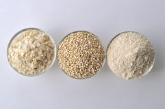Quinoa in three forms - flour, flakes and grain. Alternative gluten-free grain Royalty Free Stock Images
