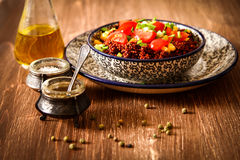Quinoa with tomatoes chilli and corn on a plate Royalty Free Stock Photo