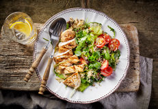 Quinoa and vegetable salad and grilled chicken Royalty Free Stock Photo