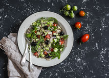 Quinoa and vegetables salad on a dark background. royalty free stock photos