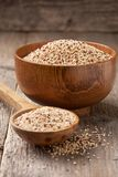 Quinoa in a wooden bowl Stock Images